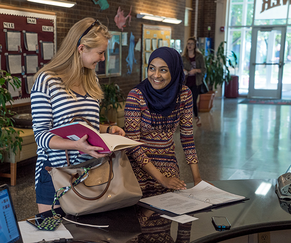 Students interacting in the common area of a residence hall