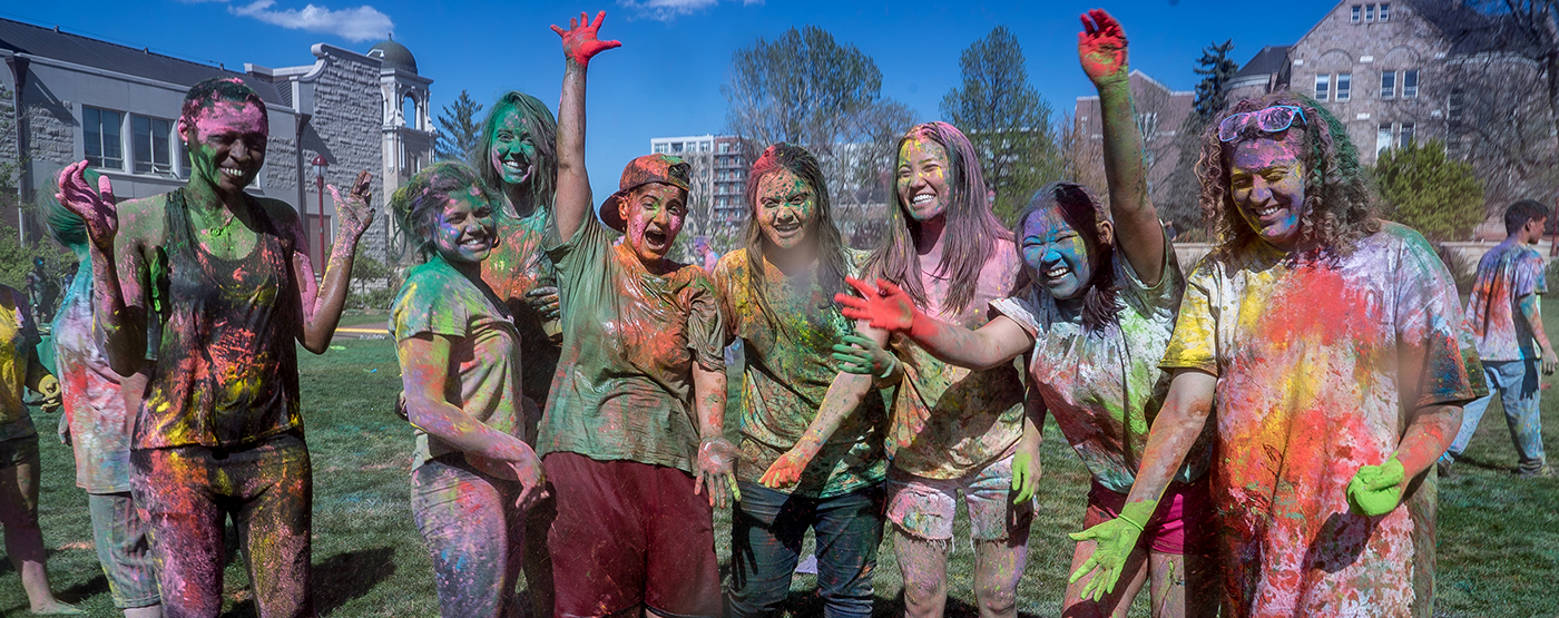 Students celebrating Holi festival on the quad