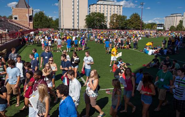 Students gather on the green during orientation week