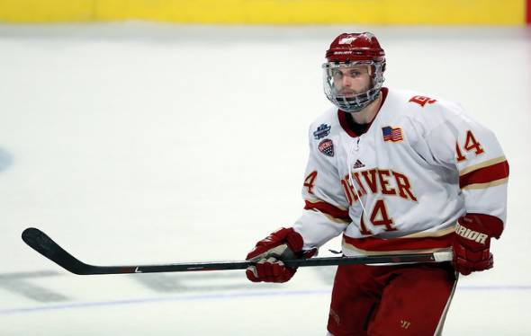 DU hockey player stares down an opponent