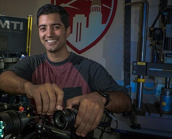 Yashar Behnam with a prosthetic prototype