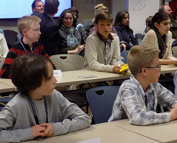 Young students earnestly waiting in a classroom at the geography bee