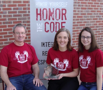 HCAC accepting the Campus of Integrity Award