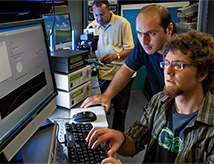 Student and professor working together on a research project in the computer lab