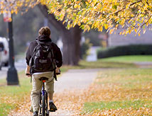 Student riding his bike across the DU campus