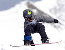 Snowboarder riding in the Rocky Mountains