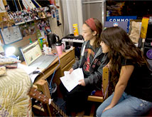 Undergraduate roommates studying in their dorm room