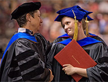DU student receiving diploma at graduation