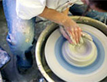 Student working on the pottery wheel