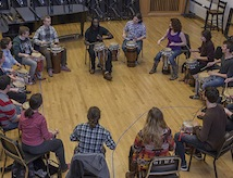 A group of DU students participate in a drum circle.