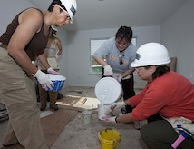 Women's College Dean Lynn Gangone works with fellow colleagues through Habitat for Humanity.