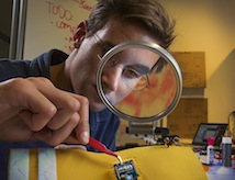 A DU student works in a University lab.