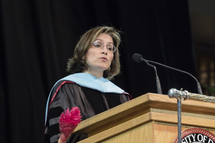 Susana Cordova (BA '88) speaks at graduate commencement in 2016. Cordova is a first-generation college student who is now deputy superintendent at Denver Public Schools.