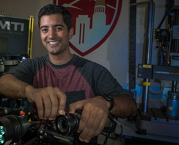 Yashar Behnam with a prosthetic prototype