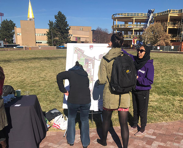 people around Map outside on campus