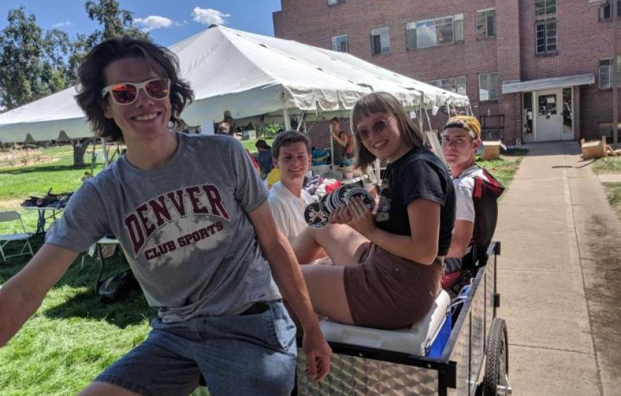 students riding a cargo bike from the center for sustainability