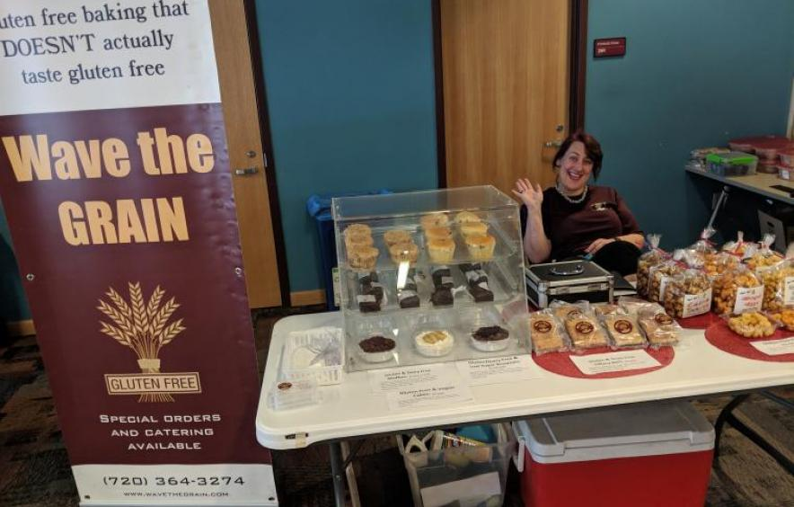 a gluten free baker waves for the camera at the 2019 Local Market