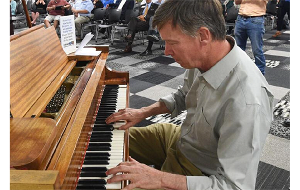 former governor john hickenlooper playing the piano