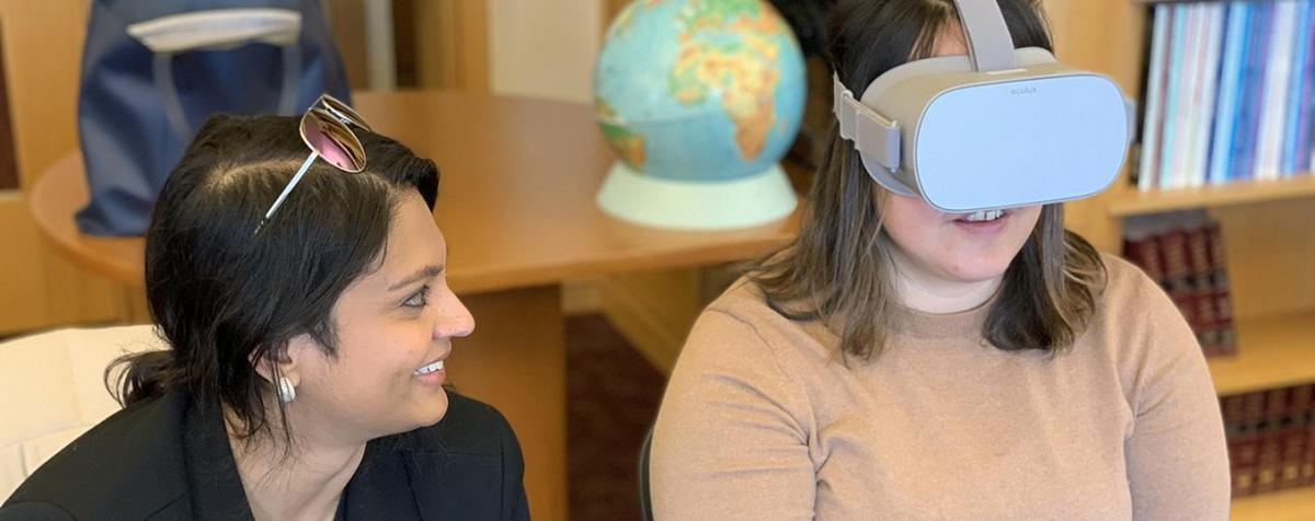 faculty and student with vr headset
