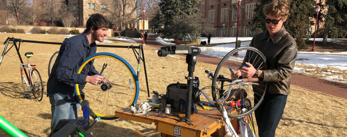 students working on bicycles