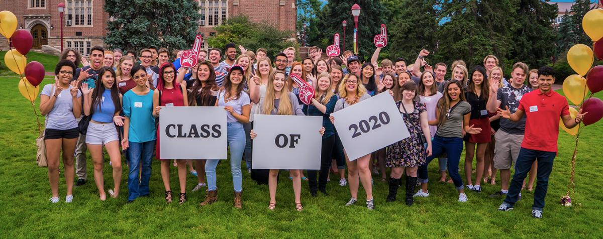 students outside holding class of 2020 sign