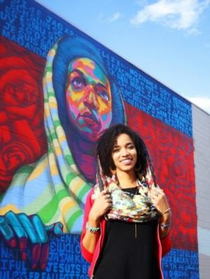 Tanya Salih poses in front of a mural painted in her likeness. (Photo: Tylar Beechum)