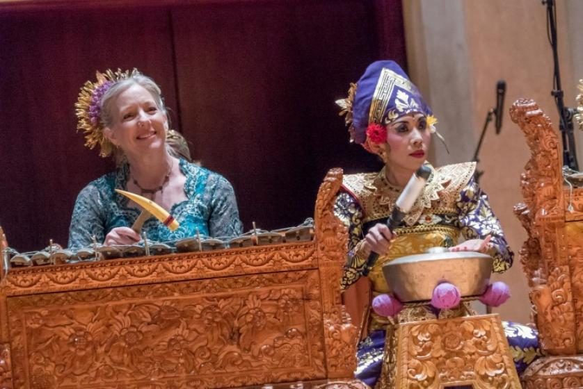 Members of the gamelan orchestra perform