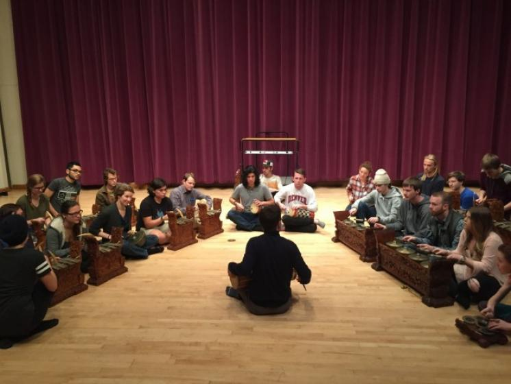 Aaron Paige's class participates in a hands-on workshop with a bronze gong gamelan orchestra