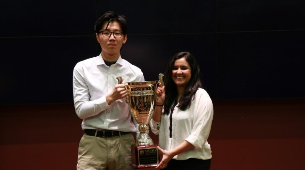 "Jiusi Zhang and Rida Noor Madden Challenge Jiusi Zhang, left, and Rida Noor pose with the Winter 2018 Madden Challenge championship trophy. The pair won the competition with their idea for an app called ""Redeemer."" Teammates not pictured: Luca Barrett-DiNatale, Eli Davidoff, Bohan Wang. (Photo: Jon DuVarney)"