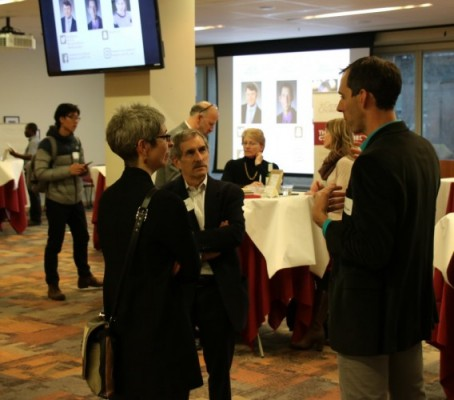 Assistant Prof. Alex Huffman engages with members of the DU community following his presentation at the Grand Challenges Forum.