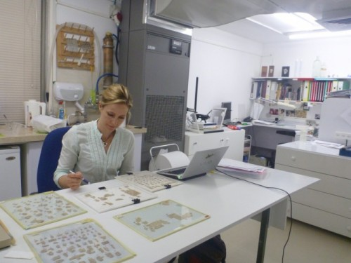 Alison Schofield works with scroll fragments at the Israel Museum.