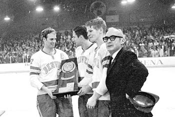 Craig Patrick, Tom Miller, Keith Magnuson and Murray Armstrong with the 1969 national championship trophy.