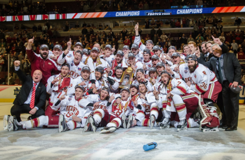 The Pioneers celebrate on the ice in Chicago after winning last year's national championship