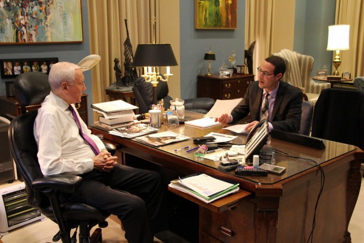 Stuart Portman (BA, '13), right, discusses healthcare policy with Utah Sen. Orrin Hatch in his Washington, D.C. office.
