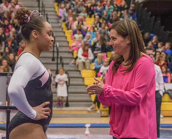 University of Denver gymnast Nina McGee gets encouragement from her coach.