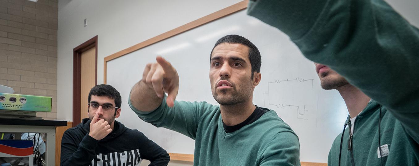 graduate students looking at computer