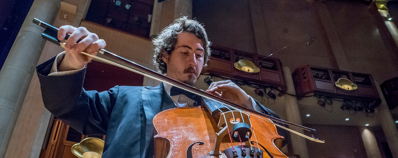 Man plays cello at a University of Denver performance