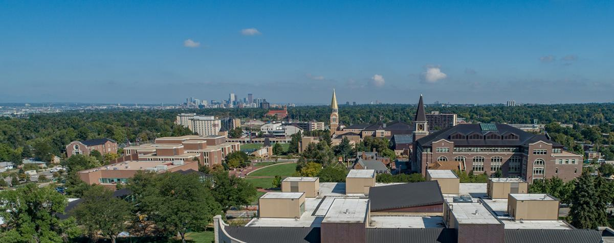 arial view of campus and denver skyline