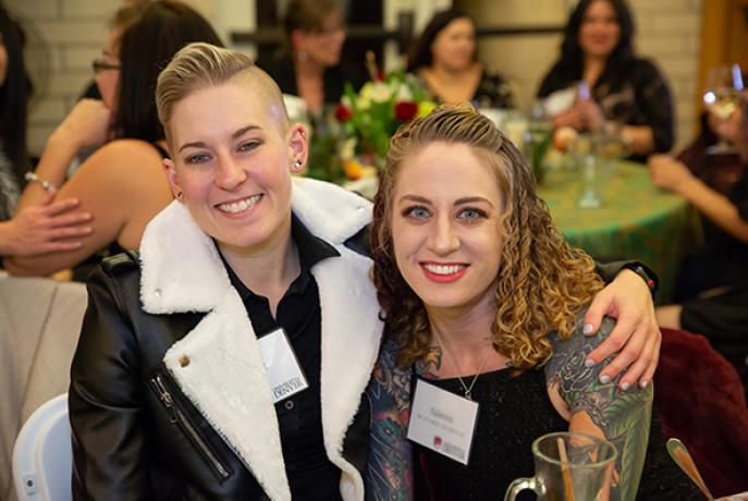 two women at dinner event