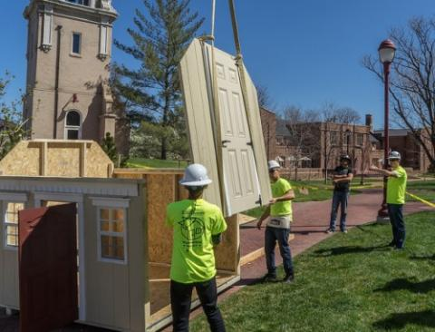 Students construct a playhouse in April 2016