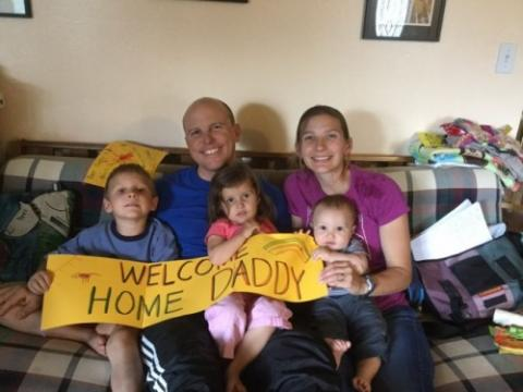 Brad Davidson with his family after arriving home