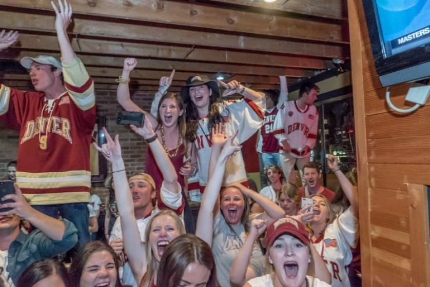 Pioneer fans celebrate the national championship at Crimson and Gold. Photo courtesy: Wayne Armstrong, University of Denver